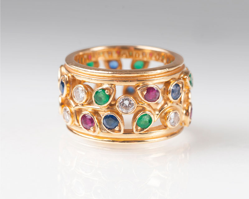 A colourful precious stone gold ring by Cartier