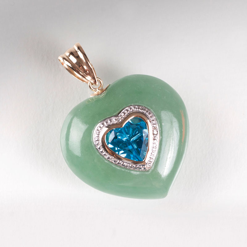 A heartshaped jade pendant with topaz setting