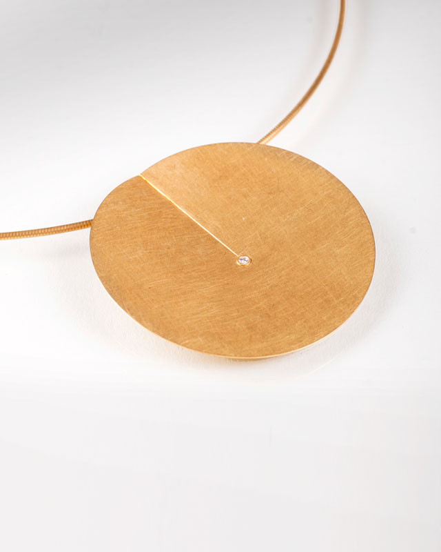 A golden necklace with small diamonds by Niessing