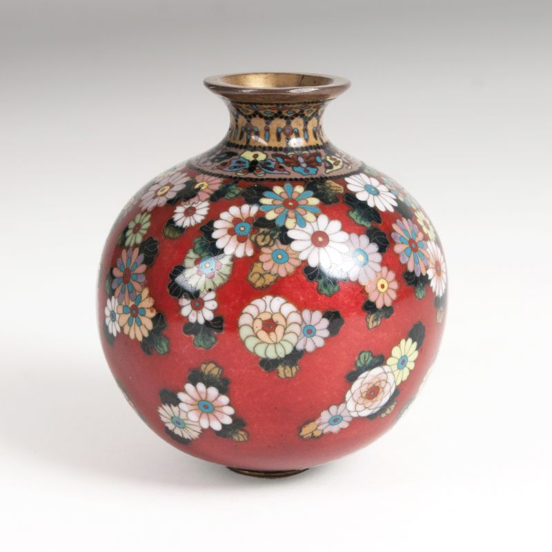 A small Cloisonné bellied vase with rich floral decor