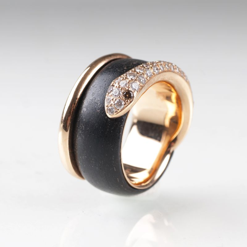 A gold precious wood ring 'Snake' with diamonds by Leo Wittwer