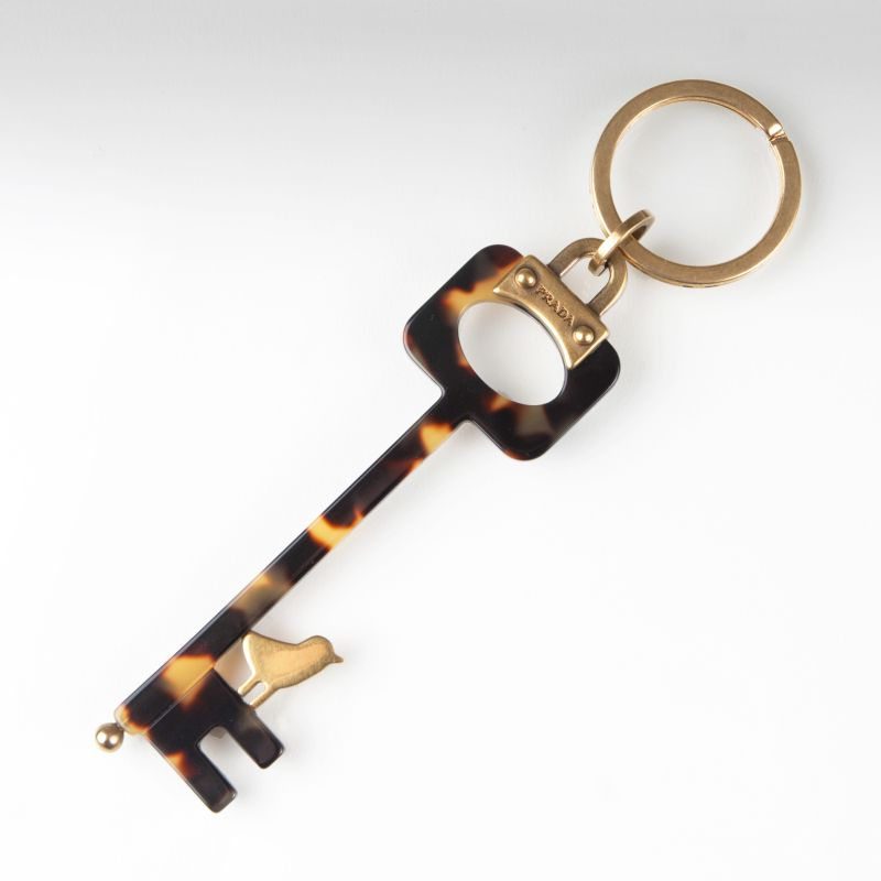 A key ring with bird decor