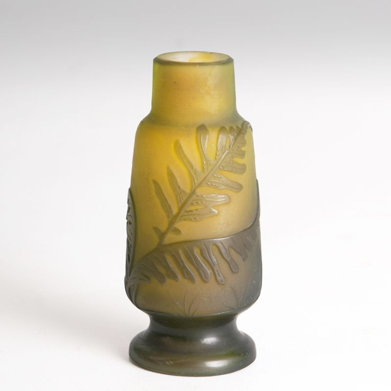 A miniature vase with ferns