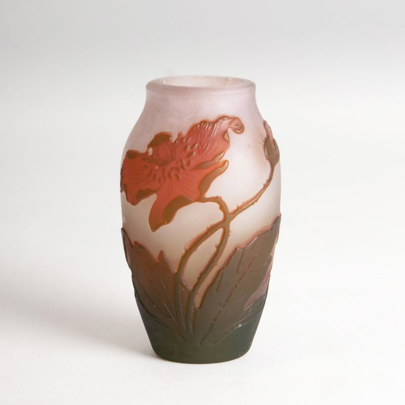 A miniature vase with poppies