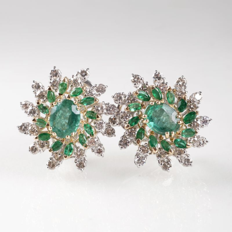 A pair of flower earrings with emeralds and diamonds