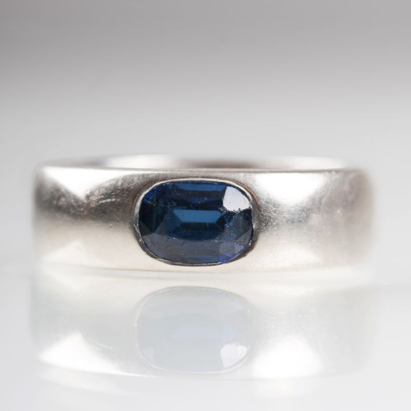 A gold ring with sapphire