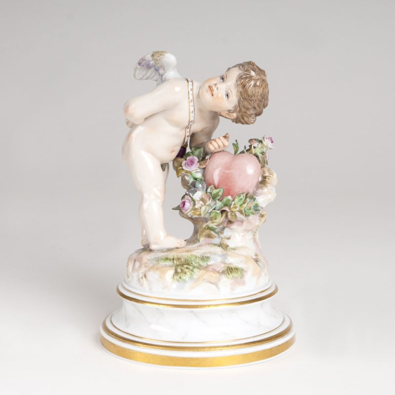 A porcelain figure 'Cupid knocking at a heart'