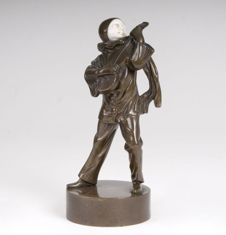 An art deco bronze 'pierrot playing the guitar'