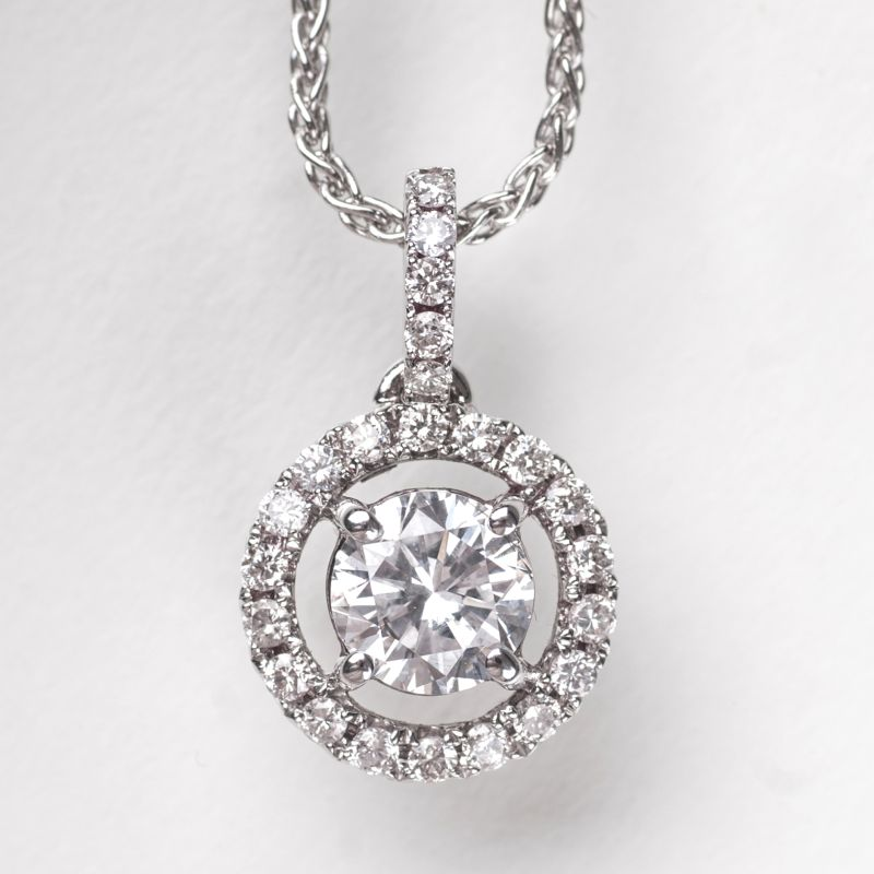 A solitaire diamond pendant with necklace