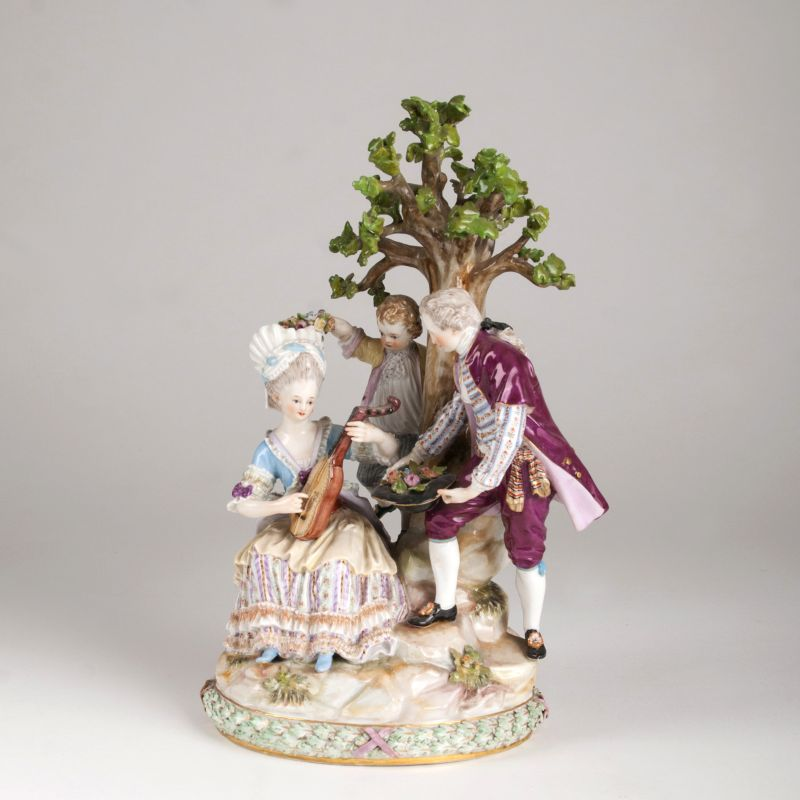 A porcelain figure group 'Cavalier  and lady with lute'