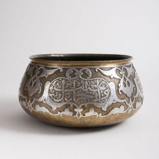 A rare large Mamluk Revival bowl with silver and brass overlay