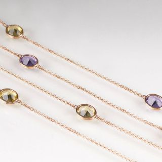 A long, modern necklace with citrine and amethyst