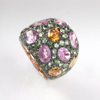 A modern, colourful ring with pink-tourmaline, citrine and tsavorith