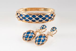 A Vintage bangle bracelet and a pair of earpendants with enamel and diamonds