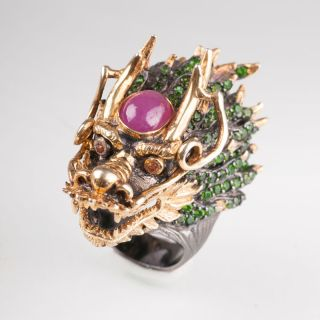 An impressive dragon ring with multi coloured stones