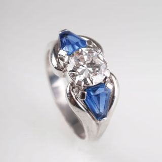 A solitaire diamond ring sapphires