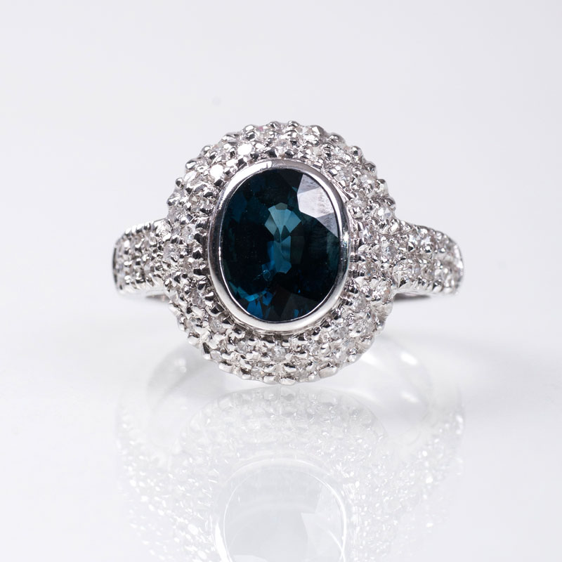 A diamond ring with coloured stone