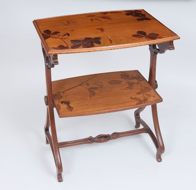 An Art Nouveau two-tier table with marquetry decor