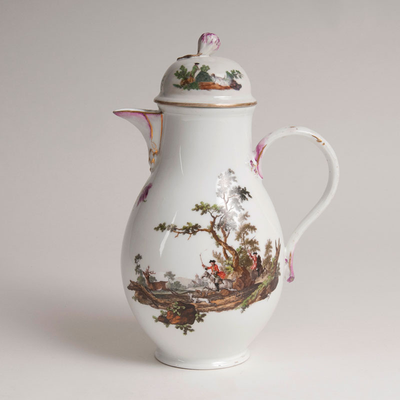 A coffee pot with hunting scenes