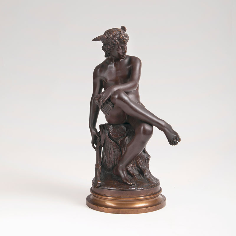 A bronze sculpture 'Seated young Hermes'