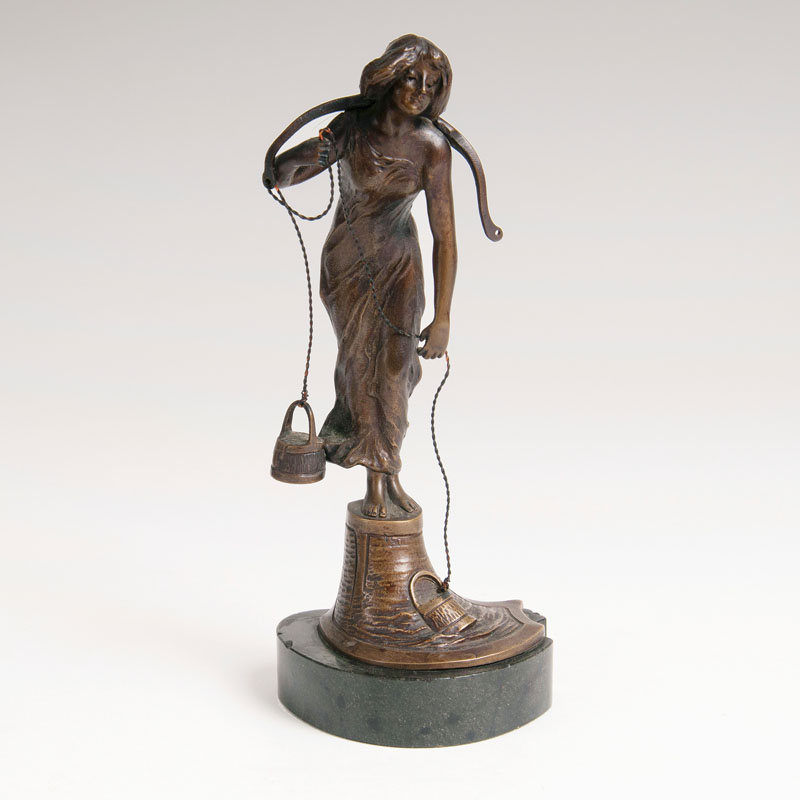 A small bronze figure 'The Water Carrier'