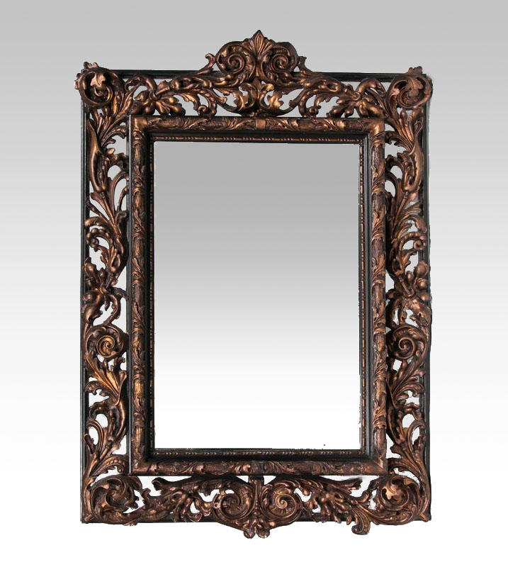 A large Baroque Mirror with Florentine frame