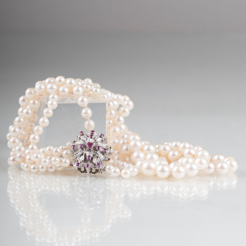 A pearl necklace with ruby diamond clasp