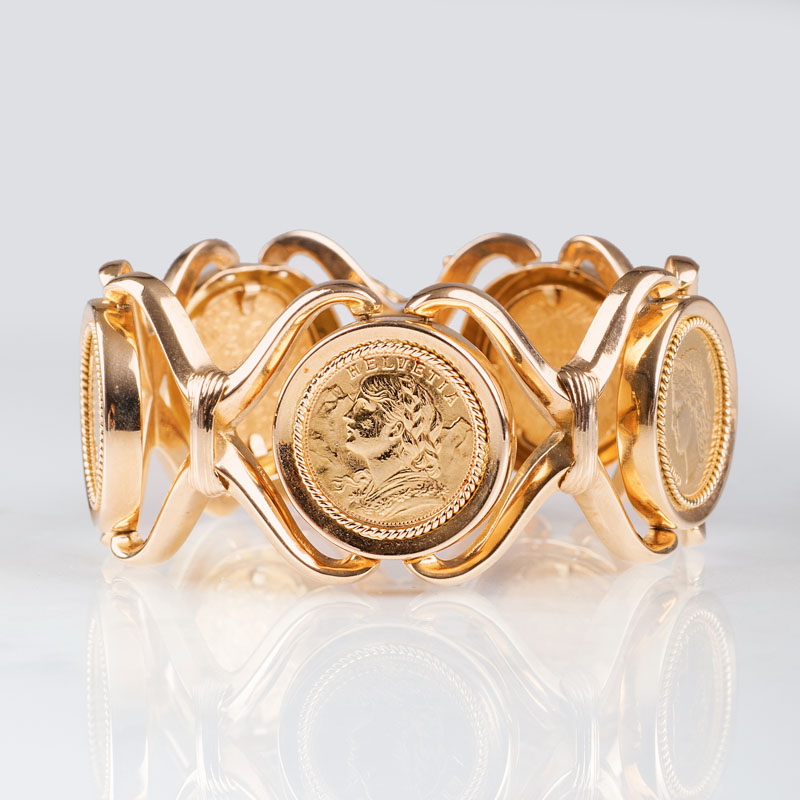 A golden bracelet with 5 coins