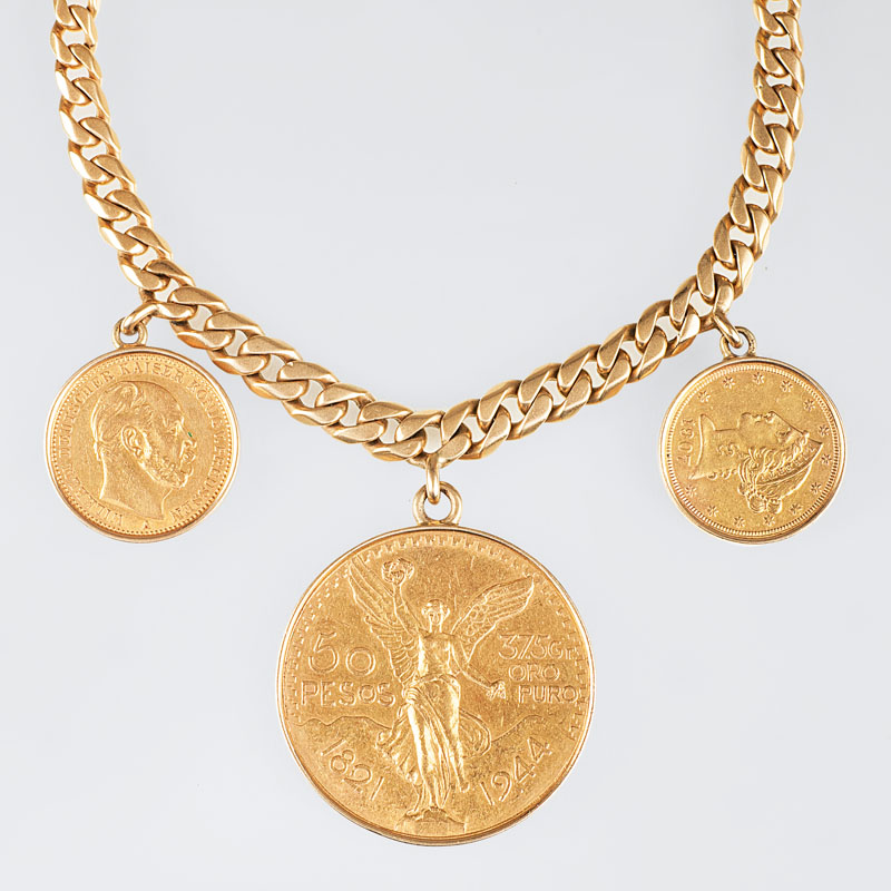 A curb chain bracelet with 3 coin pendants in gold