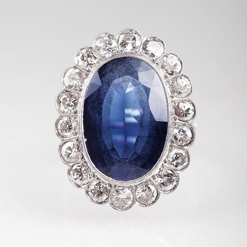 A platinum ring with diamonds and synthetic sapphires