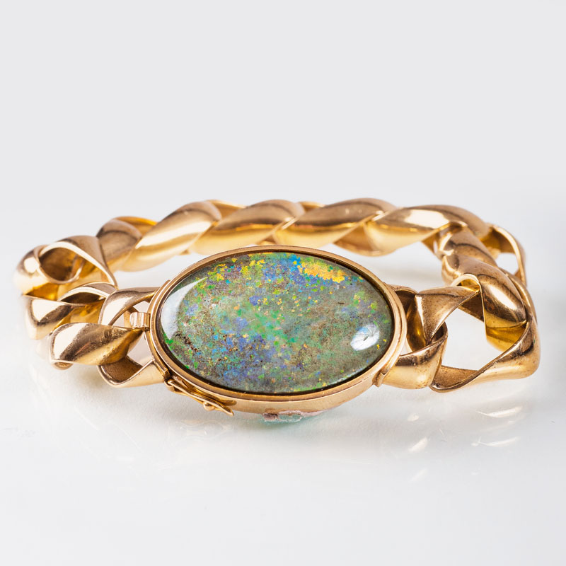 A golden bracelet with opal clasp