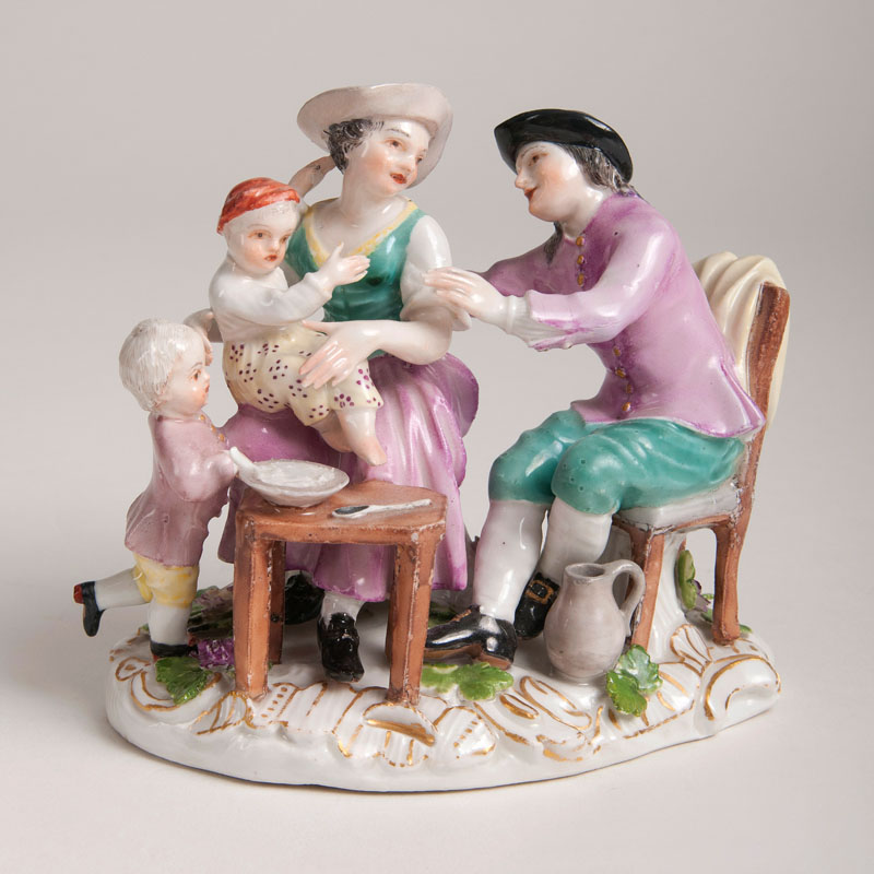 A small porcelain group with a Dutch family