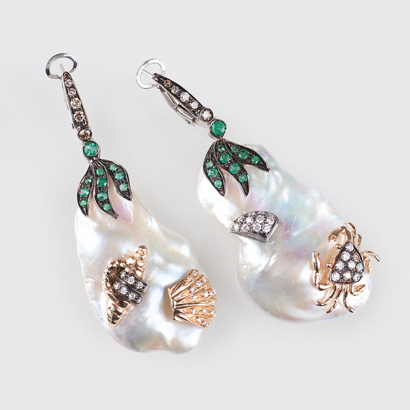 A modern pair of pearl earpendants with emeralds and diamonds