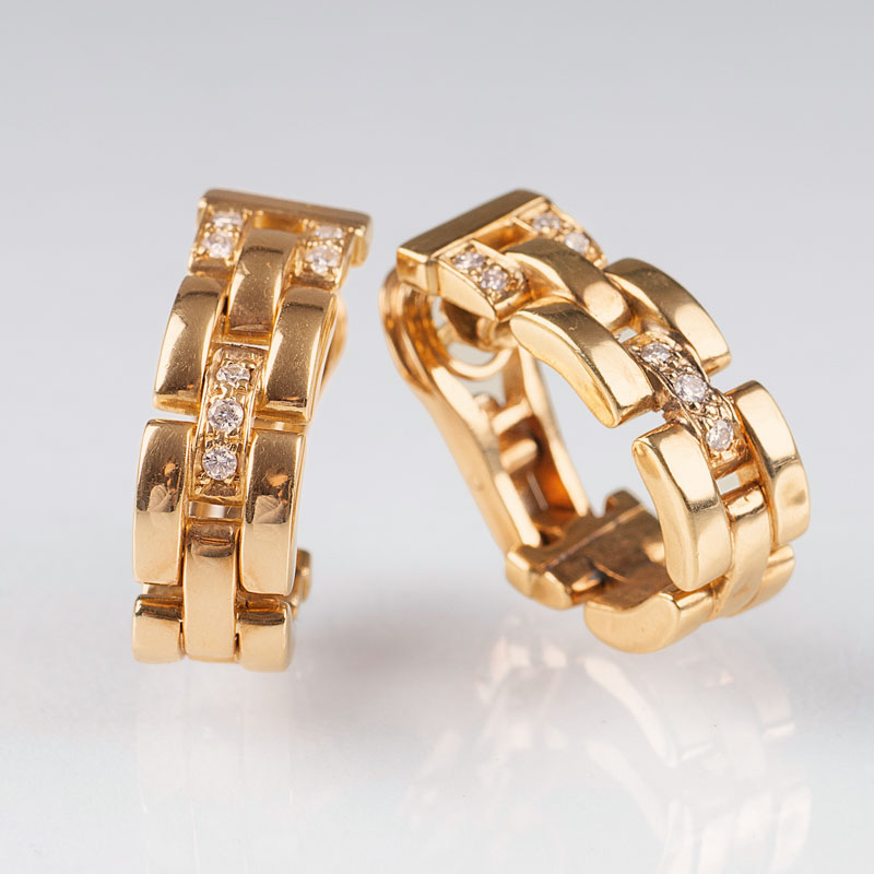 A pair of gold diamond earrings by Cartier