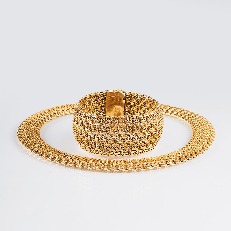 A golden necklace with matching bracelet
