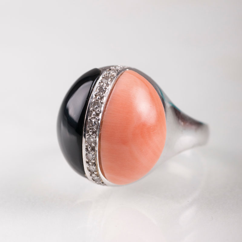 An onyx coral ring with small diamonds