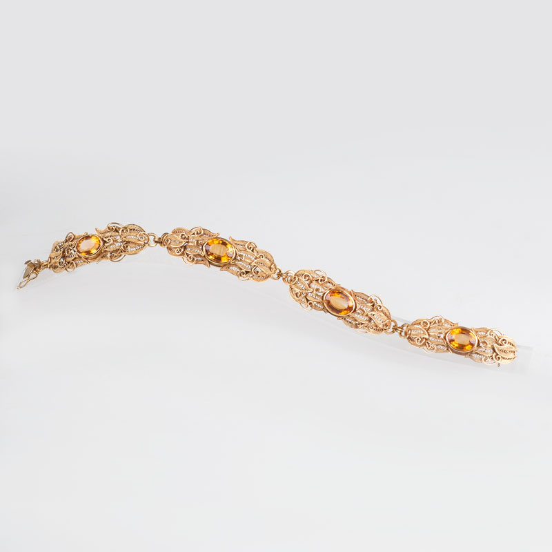 A gold bracelet with citrin