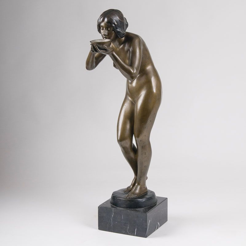 A tall bronze figure 'Drinking female nude'