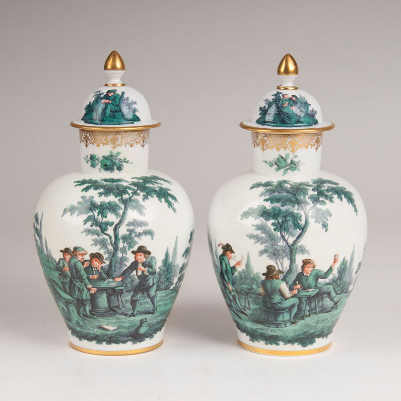 A pair of lidded vases with copper green Teniers painting