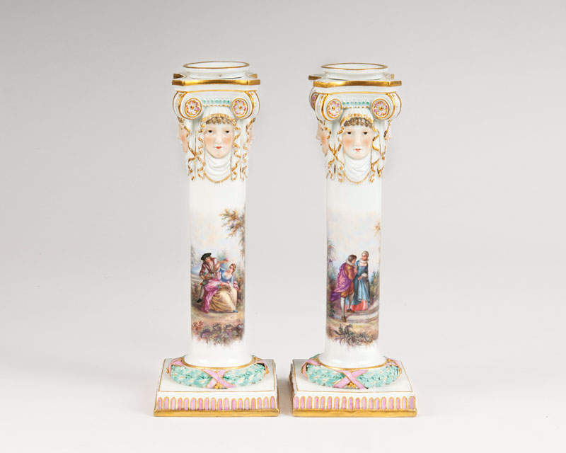 A pair of candlesticks with Watteau painting
