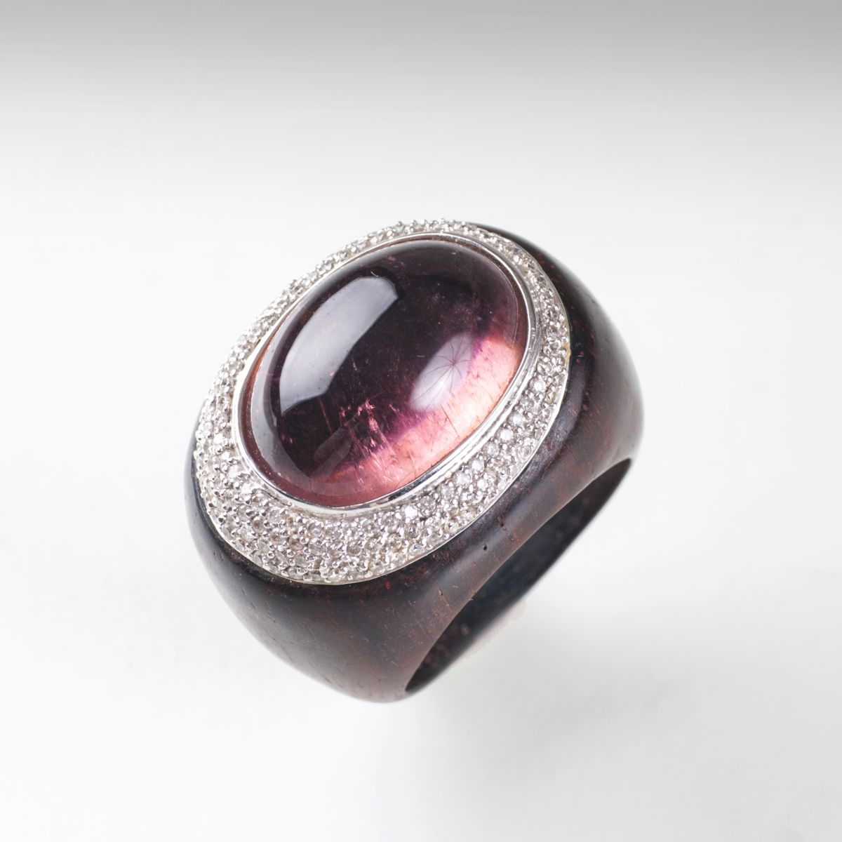A modern precious wood kunzite diamond ring