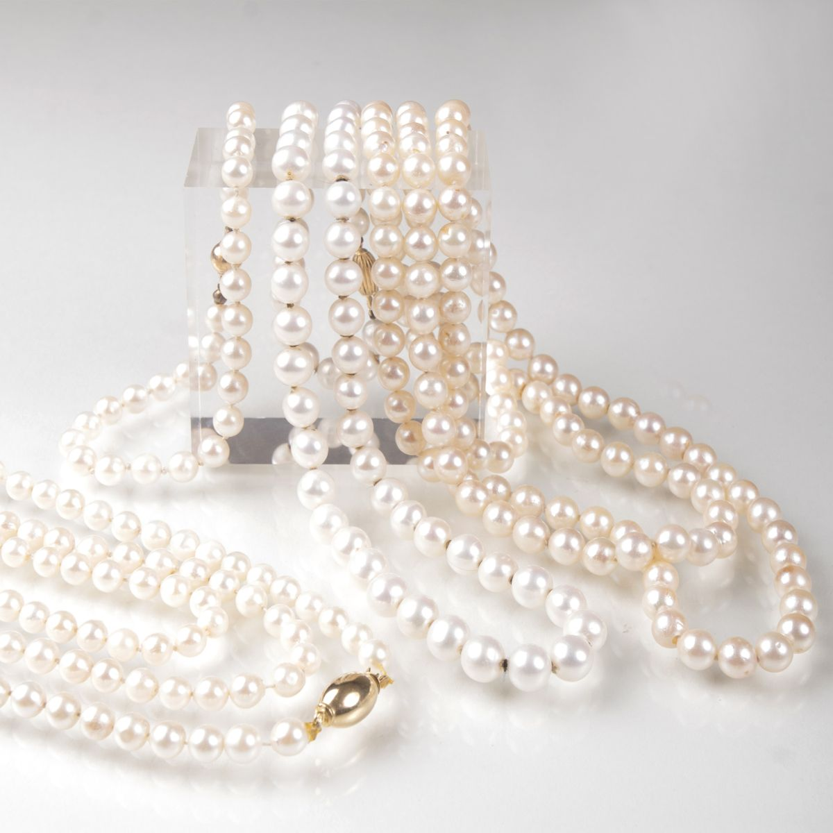 Three pearl necklaces and one pearl bracelet