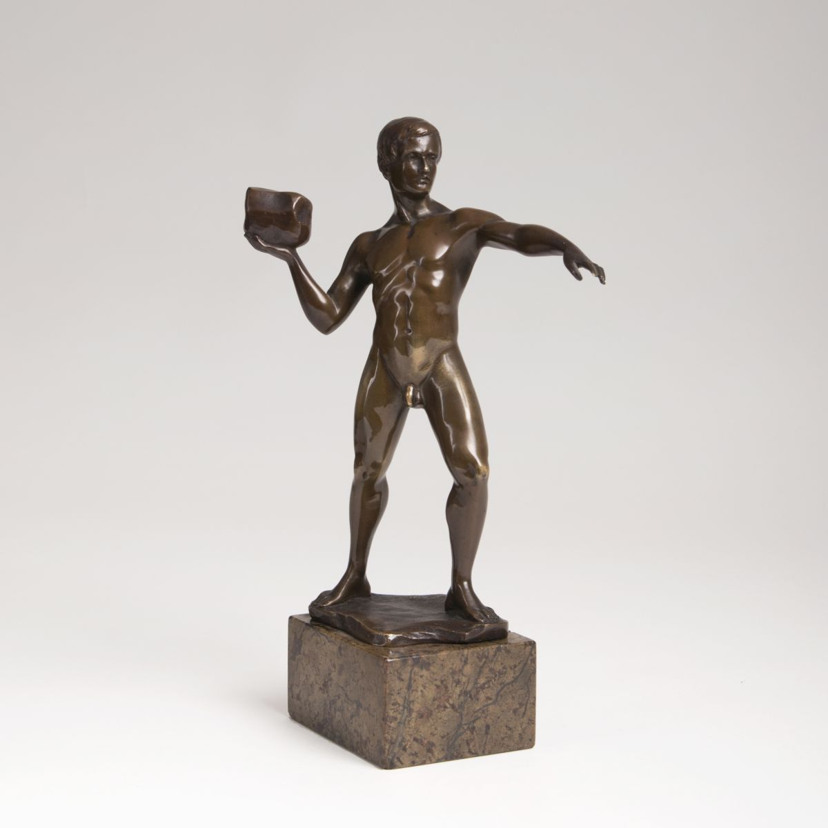 A bronze sculpture 'Thrower of stone'