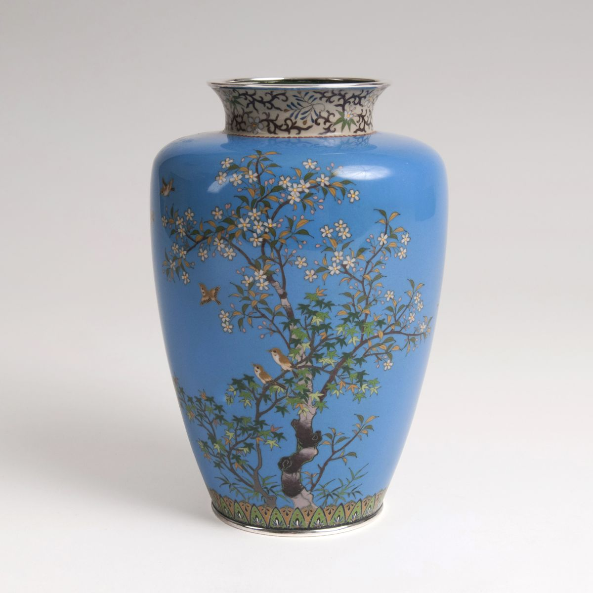 A Cloisonné vase with flowers and birds