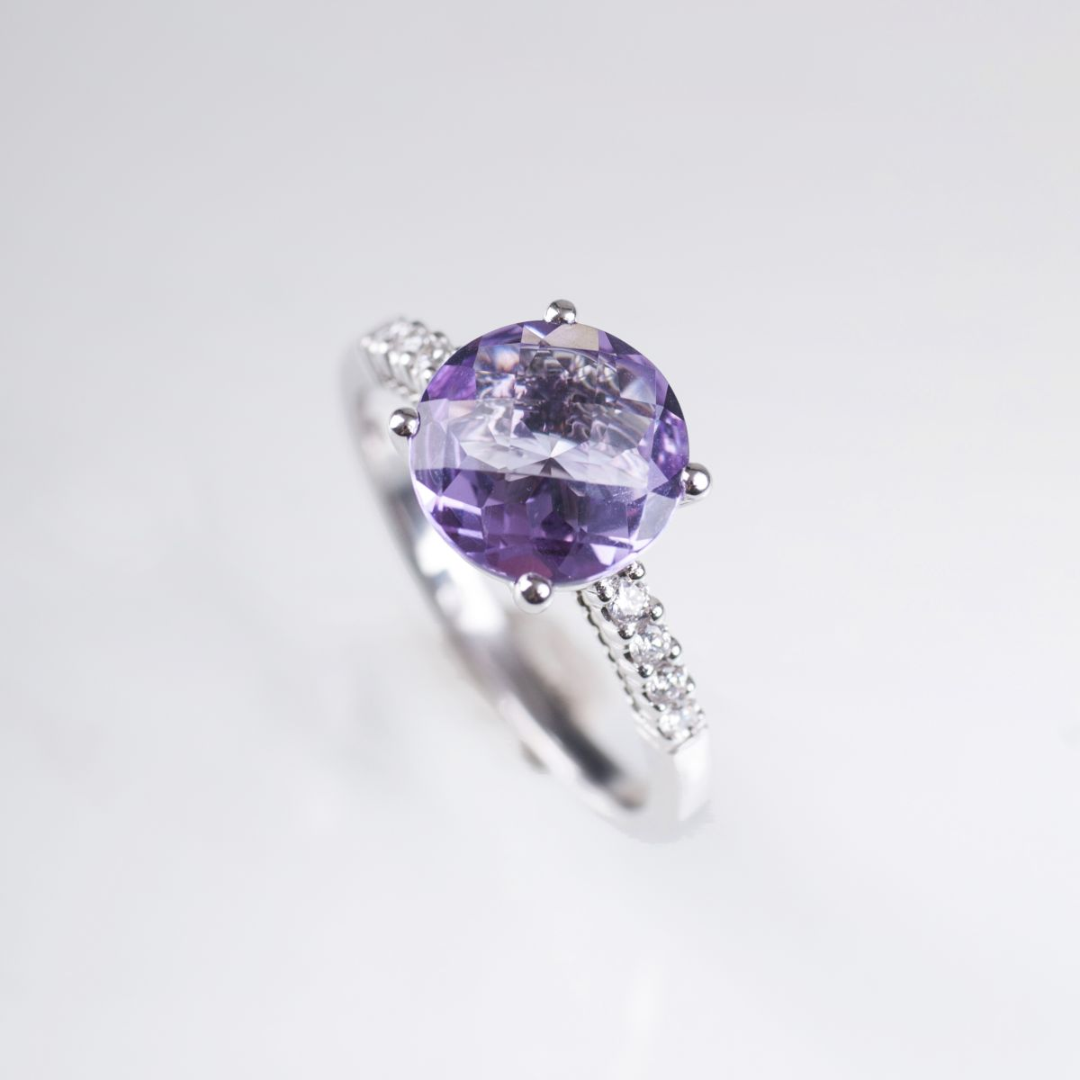 An amethyst diamond ring