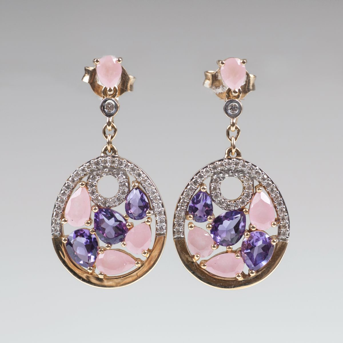 A pair of amethyst jade earpendants with diamonds