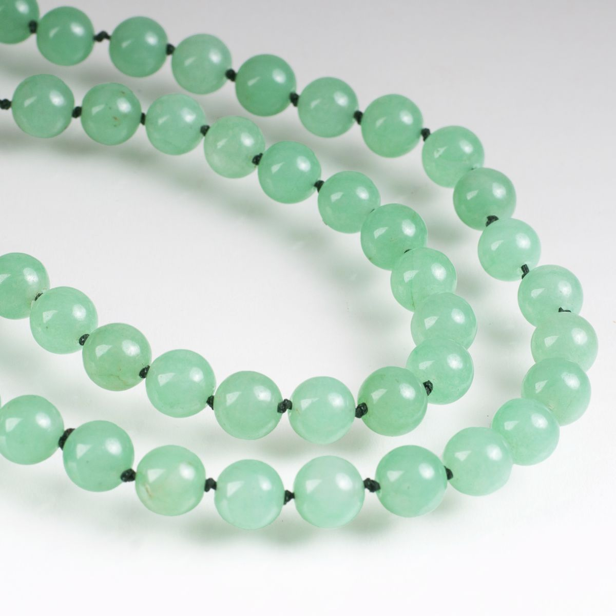 A long jade green quartz necklace