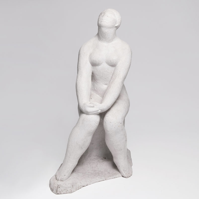 A sculpture 'Seated female nude'