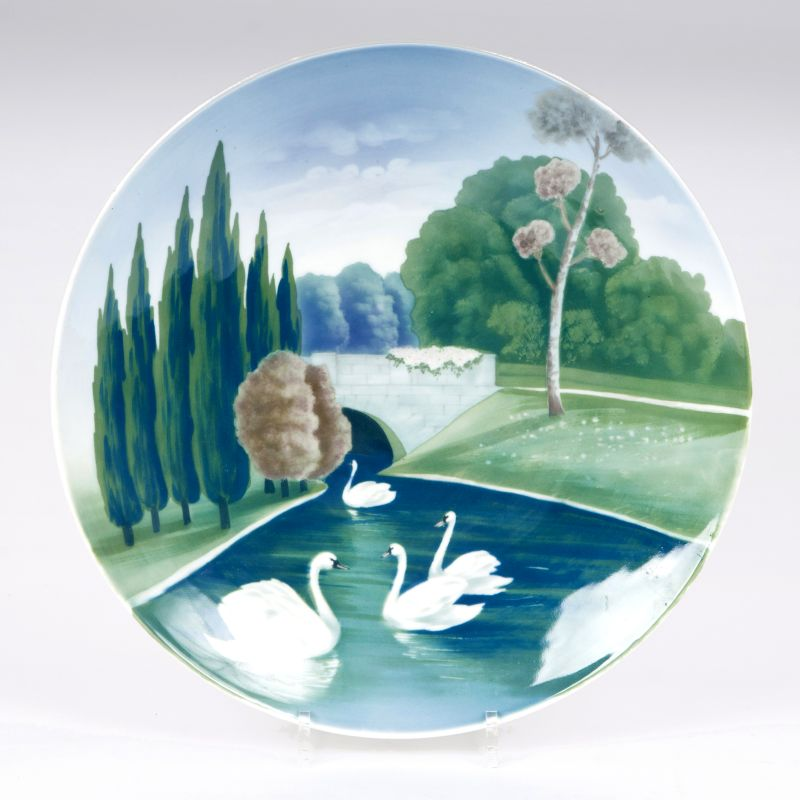 An Art Nouveau porcelain plate with swans