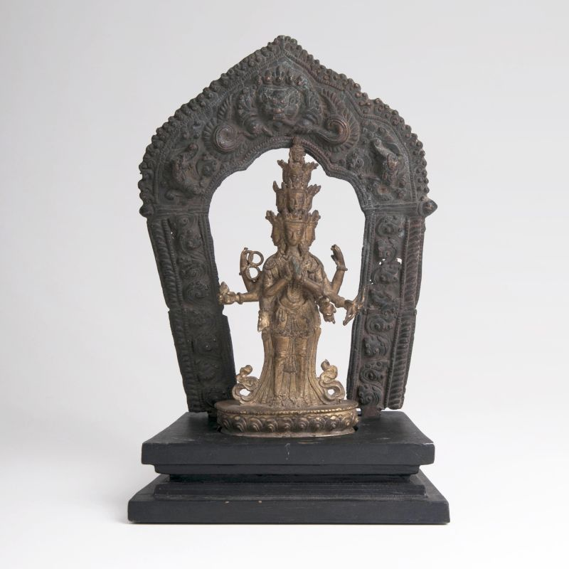 A Bronze Sculpture 'Avalokiteshvara' in front of an Aureole